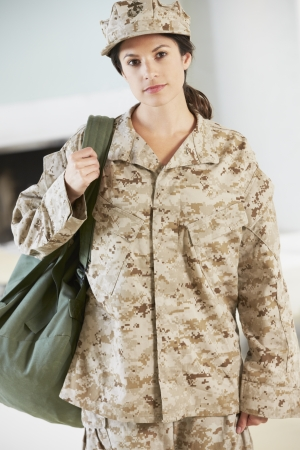 female soldier: Female Soldier With Kit Bag Home For Leave