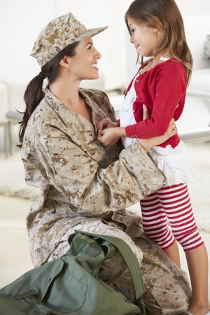 military uniform: Daughter Greeting Military Mother Home On Leave