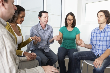five people: Bible Group Praying Together Stock Photo