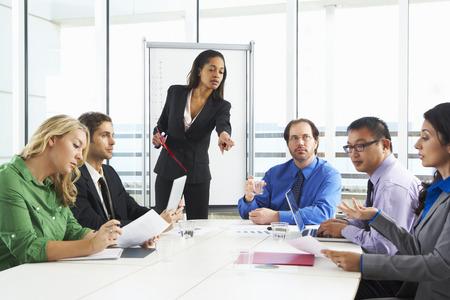 Boardroom meeting: Businesswoman Conducting Meeting In Boardroom