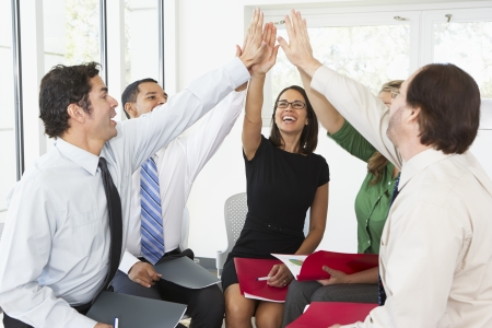 female office worker: Business Team Giving One Another High Five