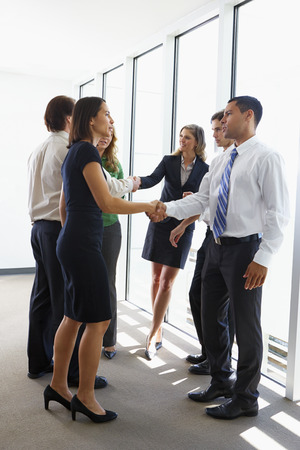 business attire: Business Team Having Informal Meeting In Office