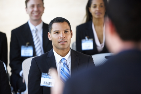 delegates: Delegates Listening To Speaker At Conference Stock Photo