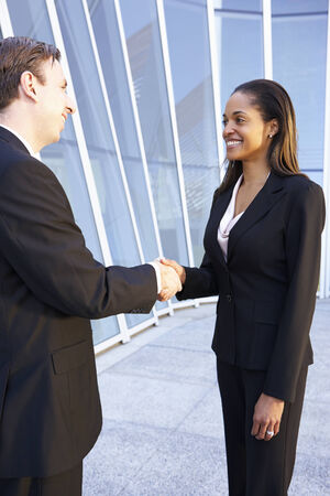 Businessman And Businesswomen Shaking Hands Outside Office Stock Photo - 24488291
