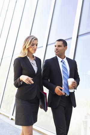 takeaway: Businesspeople With Takeaway Coffee Outside Office