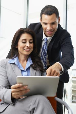 black businessman: Businesspeople With Digital Tablet During Informal Meeting
