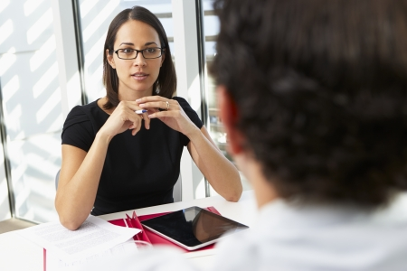 interviewing: Businesswoman Interviewing Male Candidate For Job Stock Photo