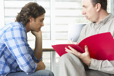 supportive: Man Having Counselling Session