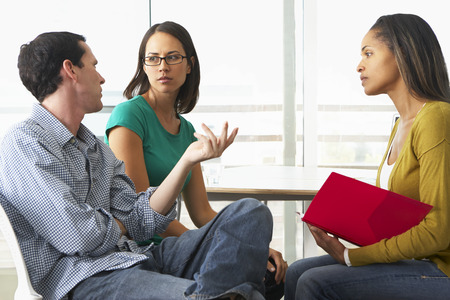 relationship problems: Couple Having Relationship Counselling Stock Photo