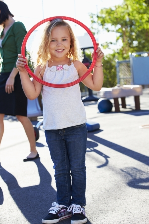 Girl In School Playground With Hoop photo