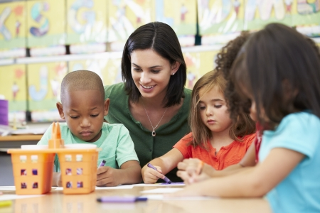 preschool children: Group Of Elementary Age Children In Art Class With Teacher