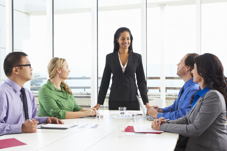 african american male: Businesswoman Conducting Meeting In Boardroom
