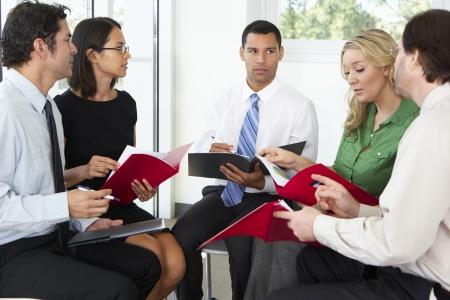 female office worker: Businesspeople Having Informal Office Meeting