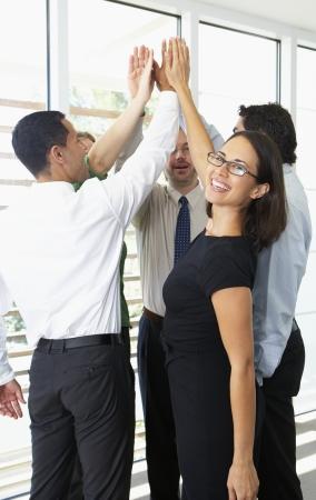Business Team Donner un autre High Five Banque d'images - 24488543