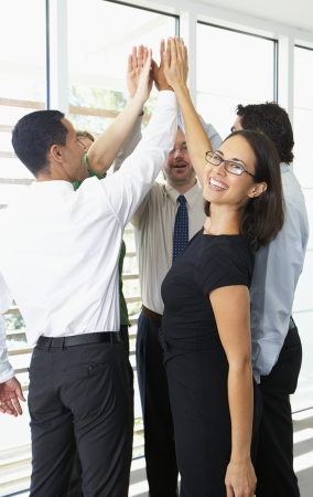 happy team: Business Team Giving One Another High Five