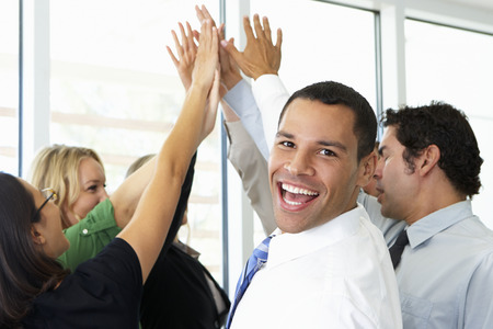 african american woman business: Business Team Giving One Another High Five