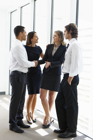 Business Team Having Informal Meeting In Office Stock Photo - 24488552