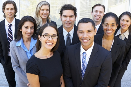 a person: Portrait Of Business Team Outside Office Stock Photo