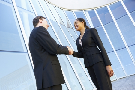 Businessman And Businesswomen Shaking Hands Outside Office Stock Photo - 24488563