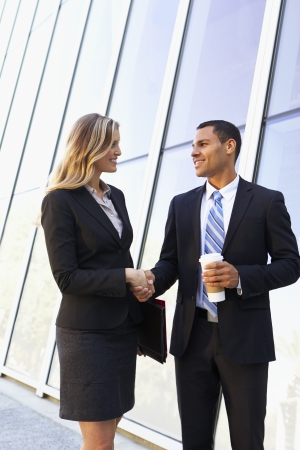 businesses: Businessman And Businesswomen Shaking Hands Outside Office