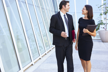 Businessman And Businesswomen Walking Outside Office photo