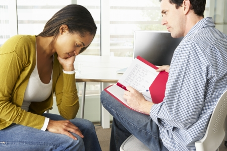counsellor: Woman Having Counselling Session