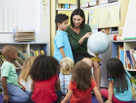 4 5 year old: Elementary Pupils In Geography Class With Teacher