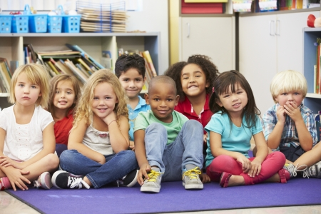 multi racial groups: Group of Elementary Pupils In Classroom