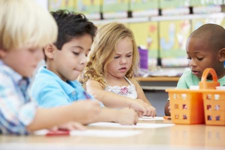 preschool education: Group Of Elementary Age Children In Art Class Stock Photo