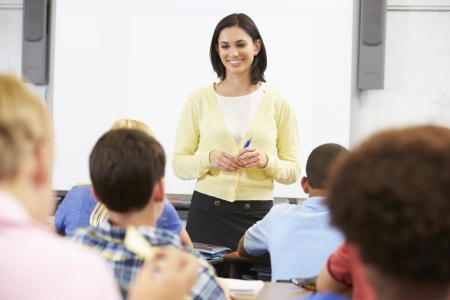 Teacher Standing In Front Of Class Of Pupils