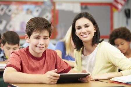 classroom teacher: Pupils In Class Using Digital Tablet With Teacher