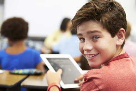 Pupil In Class Using Digital Tablet Stock Photo
