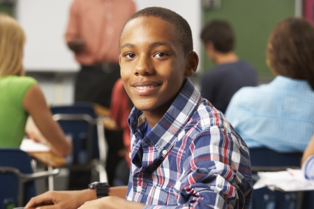 male teenager: Male Teenage Pupil In Classroom