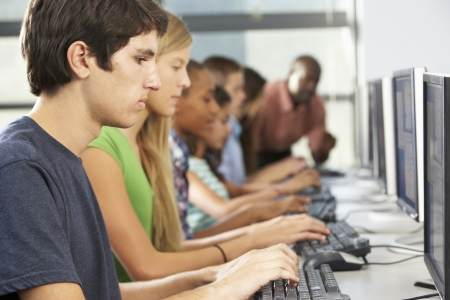 secondary school student: Group Of Students Working At Computers In Classroom