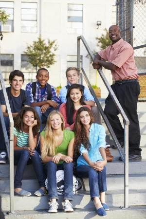 13 year old boy: Group Of Teenage Pupils Outside Classroom With Teacher Stock Photo