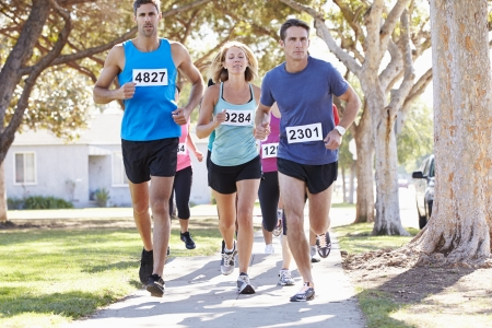 caucasian race: Group Of Runners On Suburban Street