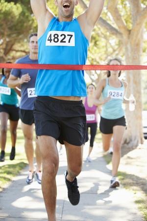 finishing line: Male Runner Winning Marathon