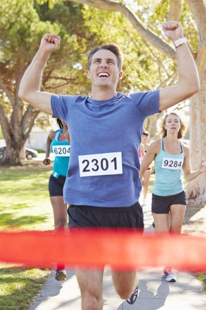 Male Runner Winning Marathon photo
