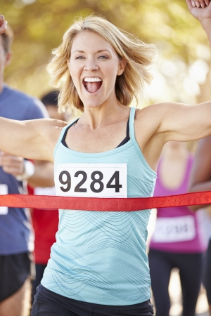 caucasian race: Female Runner Winning Marathon Stock Photo
