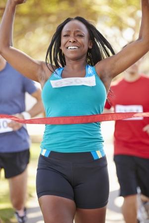 marathon: Female Runner Winning Marathon Stock Photo
