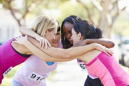 congratulating: Female Runners Congratulating One Another After Race
