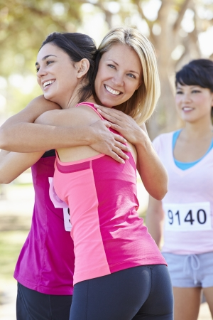 Female Runners Congratulating One Another After Race photo