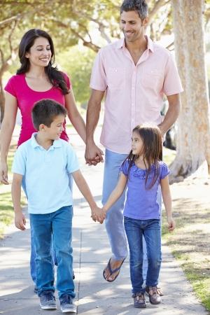 Family Walking Along Suburban Street