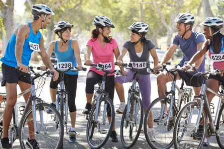 suburban street: Portrait Of Cycling Club On Suburban Street Stock Photo