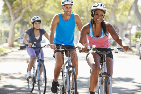 asian american: Group Of Cyclists On Suburban Street Stock Photo