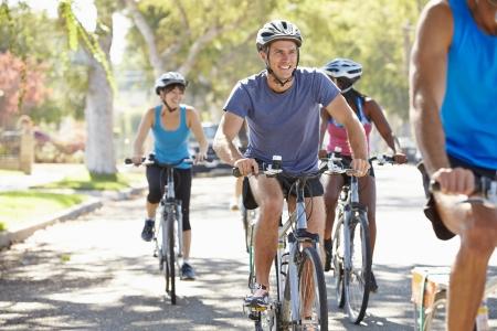 Group Of Cyclists On Suburban Street photo