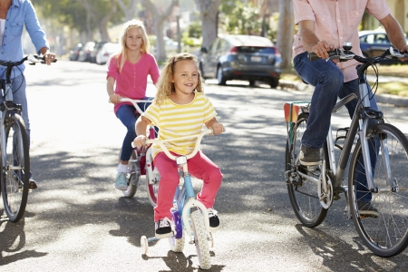 stabilizers: Family Cycling On Suburban Street