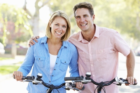 fit couple: Couple Cycling On Suburban Street