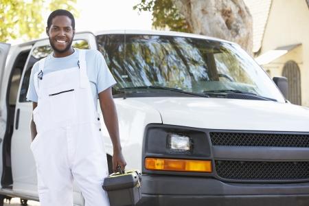 Portrait Of Repairman With Van photo