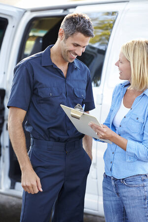 delivery man: Customer Signing For Delivery From Courier